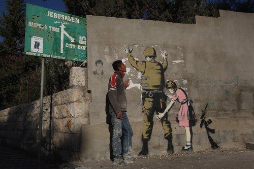 עבודתו של האמן בנקסי על חומת ההפרדה (צילום: GettyImages)